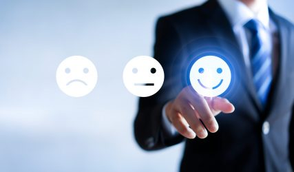 Businessman pressing happy icon, Customer service evaluation concept.